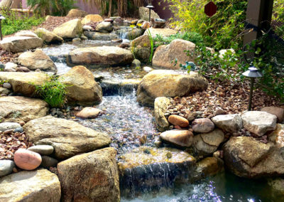 Residential Pondless Waterfall with Rock, Plants and Lighting